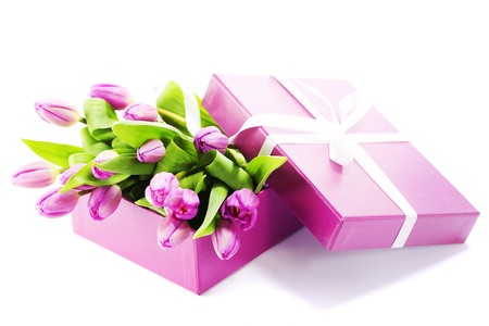 Bunch of tulips in a gift boxt on white background photo