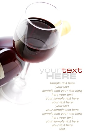wine and food: a glass of red wine over white  (with sample text) Stock Photo
