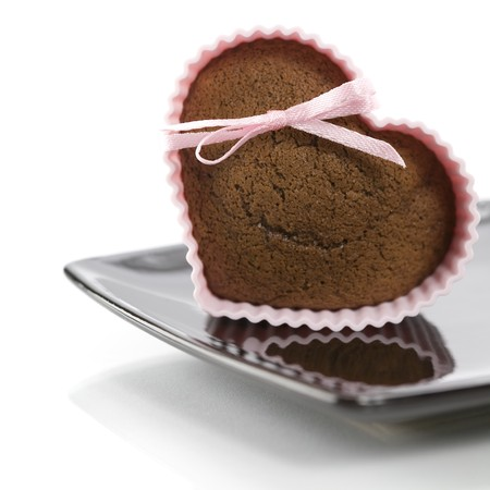 silicone: chocolate heart shape muffin in pink silicone mold Stock Photo
