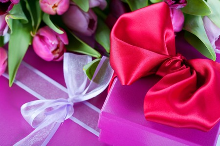 Pink tulips and gift boxes photo