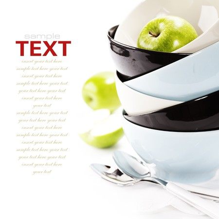 Stack of bowls and green apples Stock Photo