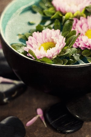 bowl of water and flowers in grunge style  photo