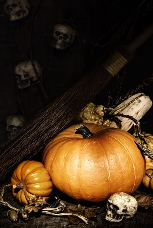 Halloween scene of a pumpkins, skulls and  witch broomstick photo