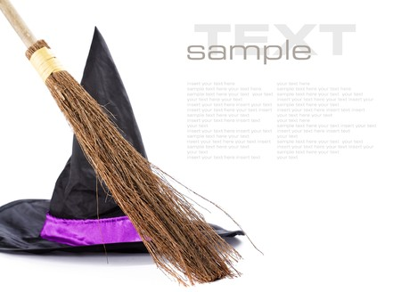 nightcap: Witch broomstick and hat isolated on white background (with sample  text)