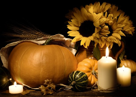 Autumn still life with pumpkins, candles and flowers photo