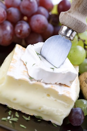 cheese platter: 2 kinds of cheese with a cheese knife and grape Stock Photo