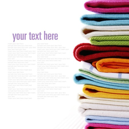 sample text: Pile of linen kitchen towels on a white background (with sample text)
