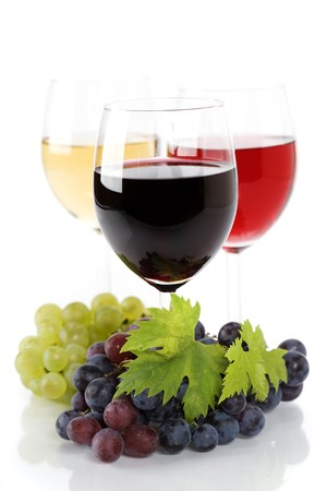Glasses of white and rose wine and grapes over white  photo