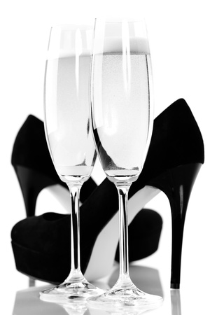 allurement: sexy high heels and champange or sparkling wine