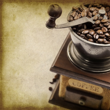 caf: Vintage coffee grinder with coffee beans (with sample text)
