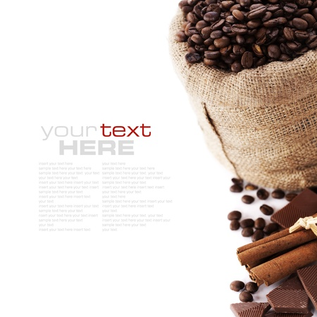 Coffee beans in canvas sack, spices and chocolate over white (with sample text) Stock Photo