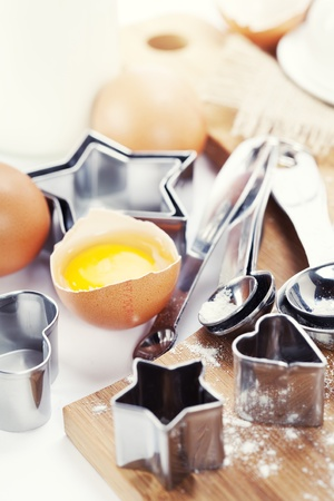 Baking cookies: eggs, flour and baking forms Stock Photo - 8630113