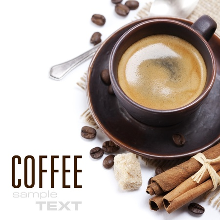 freshly prepared: Closeup shot of freshly prepared cup of italian espresso with cinnamon, coffe beans, brown sugar and chocolate over white (with sample text)