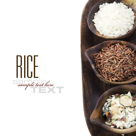 Bowls of uncooked rice over white with sample text Stock Photo - 8630128