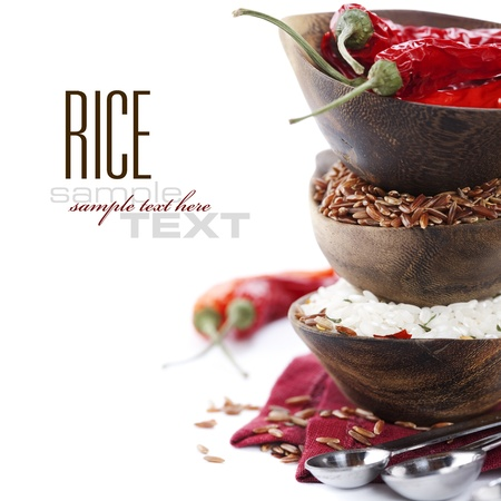 asia food: Bowls of uncooked rice over white with sample text