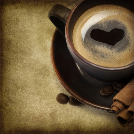 Cup Of Coffee With Heart Image On White Background (with sample text) photo