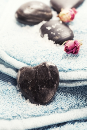 stone wash: Bath and spa Valentine theme with blue towel Stock Photo