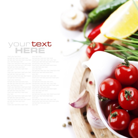 chives: Tomatos, chives, peppers, lemon, mushrooms and garlic on white background. With sample text