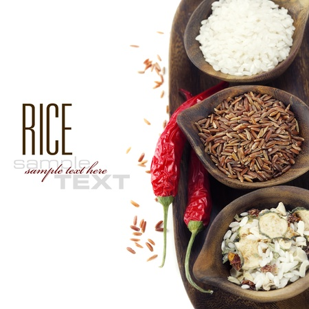 Bowls of uncooked rice over white with sample text photo