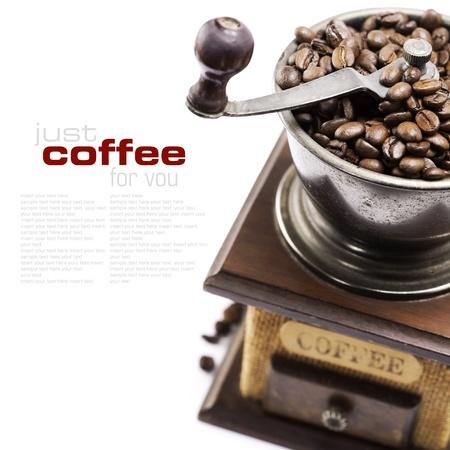 afilador: Molinillo de caf� cosecha con granos de caf� (con texto de ejemplo) Foto de archivo