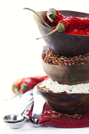 asia food: Bowls of uncooked rice over white