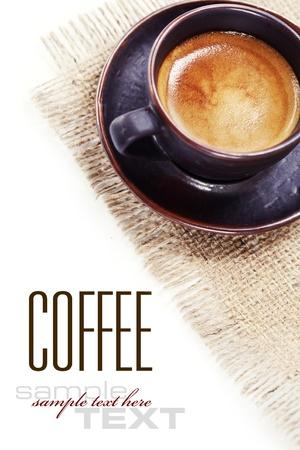 Kaffeetasse auf Sackleinen mit Beispieltext Standard-Bild