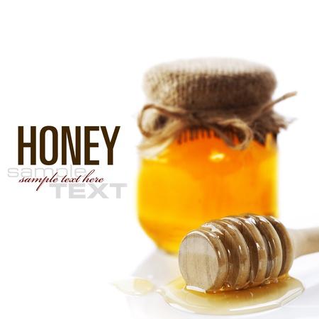 完全プロジェクトハニー ポットと蜂蜜ホワイト上とスティック (サンプル テキスト) 写真素材