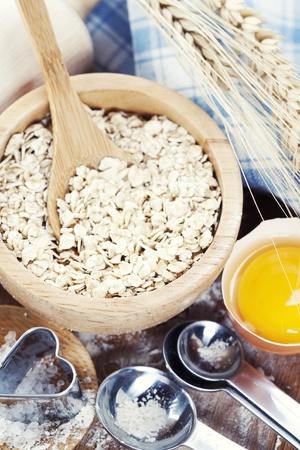 Fresh ingredients for oatmeal cookies (oat flakes, eggs, salt, flour) photo