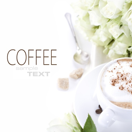 cup of coffee and a bouquet of delicate white roses on white background photo
