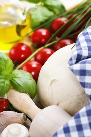 ingredients for homemade pizza(dough, cheese, olive oil and vegetables) Stock Photo - 9527422