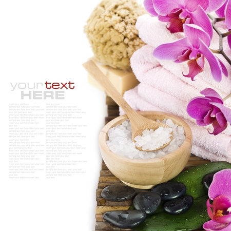 salt water: spa concept (zen stones, sea salt, towel, soap and orchid) over white with sample text Stock Photo