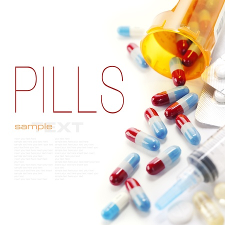 의학: Pills spilling out of pill bottle and Syringe isolated on white (with sample text)