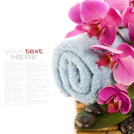 spa concept (zen stones, towel and orchid) over white with sample text photo
