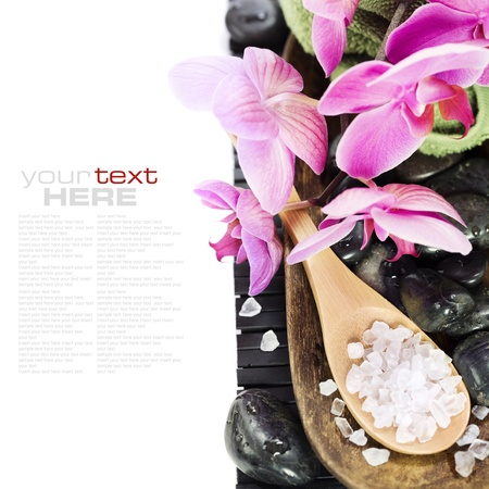 wooden aromatherapy: spa concept (zen stones, sea salt, towel and orchid) over white with sample text
