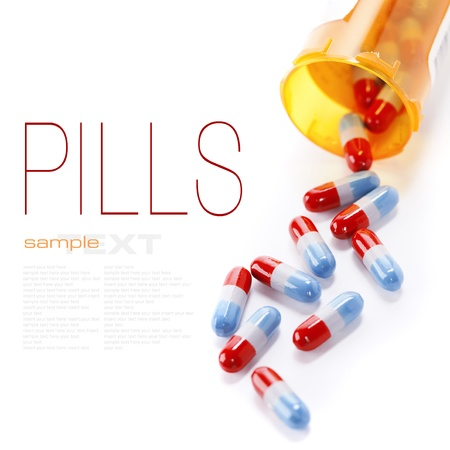 pill bottle prescription bottle: Pills spilling out of pill bottle isolated on white (with sample text) Stock Photo