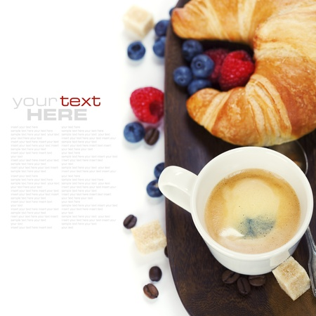 yummy: Delicious breakfast with fresh coffee, fresh croissants and fruits  (with sample text)  Stock Photo