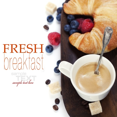 Delicious breakfast with fresh coffee, fresh croissants and fruits  (with sample text)  Stock Photo