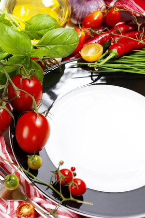 Fresh vegetables and empty plate (insert your text on a plate)