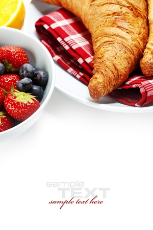 french bread rolls: Breakfast with Fresh Croissants and berries over white