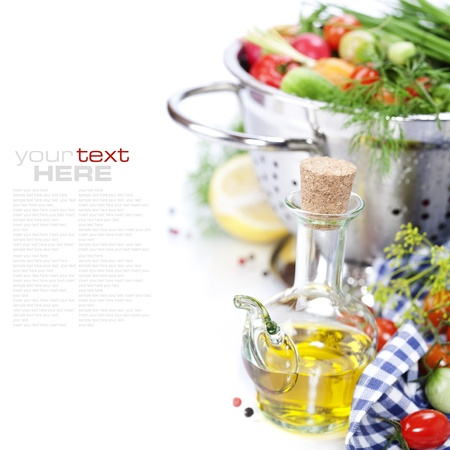 colander: Fresh vegetables in metal colander and olive oil over white (with sample text)