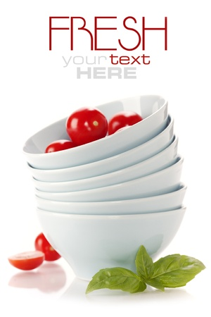 tomatos: Stack of bowls and fresh tomatoes over white (with sample text) Stock Photo