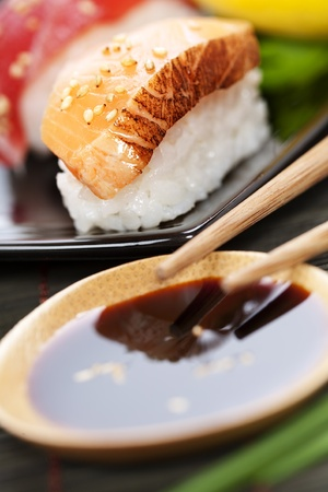 sause: set of japanese sushi with chopsticks and soy sause over white Stock Photo