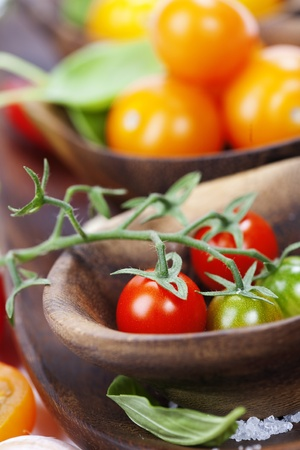 cherry varieties: Several varieties of tomatoes and basil Stock Photo