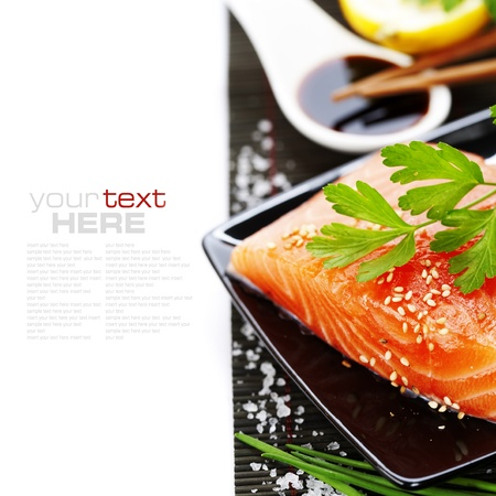 susi: traditional asian ingredients (Fresh salmon steak filet, lemon and soy sause) with chopsticks over white with sample text Stock Photo