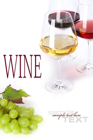 Glasses of white, red and rose wine and grapes over white (with sample text) photo