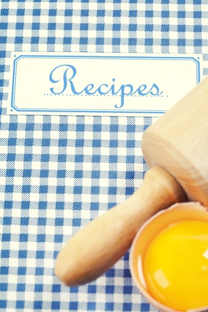 The book of recipes with egg and rolling pin photo