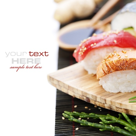 close up food: set of japanese sushi with chopsticks and soy sause over white with sample text Stock Photo