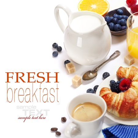 Delicious breakfast with fresh coffee, milk,  fresh croissants and fruits  (with sample text)