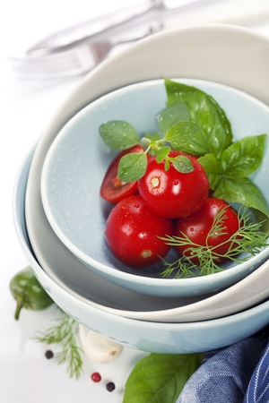 Fresh vegetables in bowls with blue napkin photo