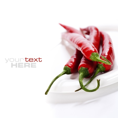 sample text: hot chili peppers on white plate (with sample text)